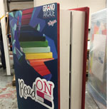 Bespoke 6ft tall book, which opens and holds hundreds of books